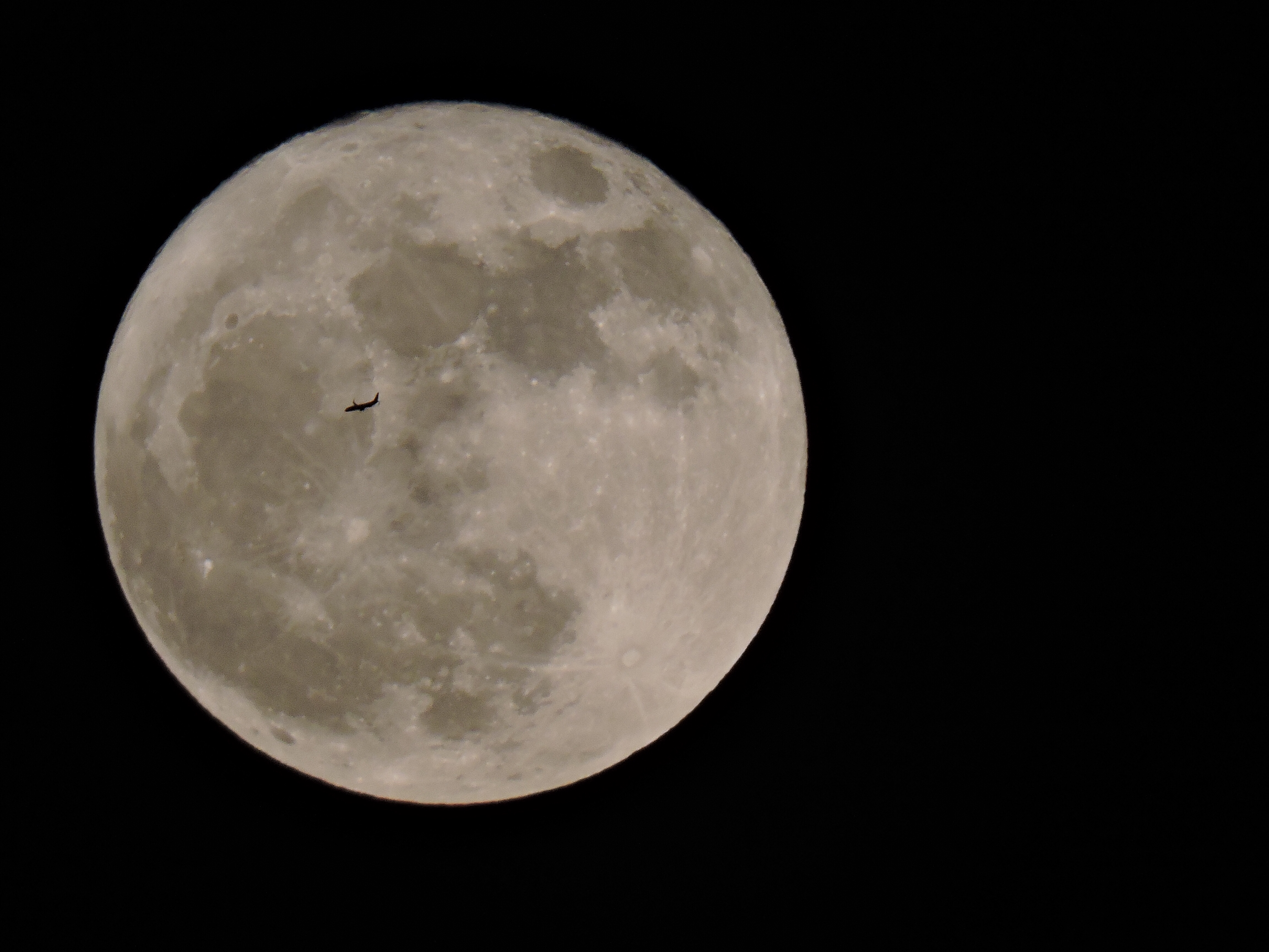 Full moon and airplane photo